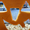 BRYAN EATON/Staff photo. A jack-o-lantern eyes view of Market Square in downtown Newburyport, one of the carved entries into the Great Pumpkin and Lighting Stroll this past Saturday. The orange orbs were removed yesterday after the photo was taken