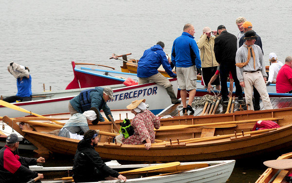 JIM VAIKNORAS/Staff photo Rowers board their vessels  during the Fall Haul and Mighty Merrimack Rowing race at Lowell Boat Shop in Amesbury.About a dozen boats competed in the race, later rowers and spectaters enjoyed burgers, a chili contest, and the music of The Demijon Music Clan.