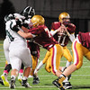 JIM VAIKNORAS/Staff photo Newburyport's JRob Shay looks for a reciever against Pentucket at Newburyport Friday night.