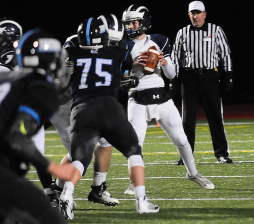 JIM VAIKNORAS/Staff photo Swampscott's Colin Frary looks for a reciever  at Triton Friday night.