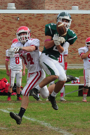 JIM VAIKNORAS?STAFF photo Masco'sPeter Kitsakos breaks up a pass intended for Pentucket'sNate McGrail during their game at Pentucket Saturday.
