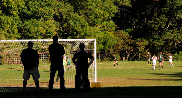 JIM VAIKNORAS/Staff photo Soccer fan watch from the shade as Amesbury girls take on Pentucket at the Cashman School in Amesbury Friday afternoon.