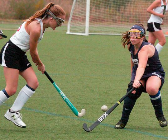 BRYAN EATON/Staff photo. Amesbury's Lydia Pinette moves the ball past Hamilton-Wenham's Connors.