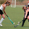 BRYAN EATON/Staff photo. Amesbury's Lydia Pinette moves the ball past Hamilton-Wenham's Connors.