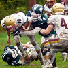 BRYAN EATON/Staff photo. Pentucket's Jordan Journeay tackles Newburyport's Jack Cahalane.