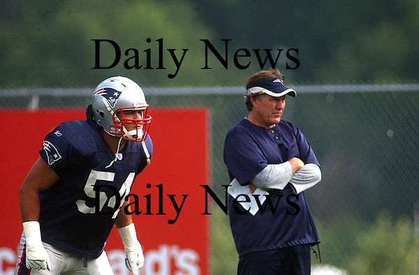 Foxboro:<br /> Middle linebacker, Teddy Bruschi, prepares to run through a defensive drill as Head Coach Bill Belichick watches closely.<br /> Photo by Ben Laing/Eagle-Tribune Friday, July 27, 2007