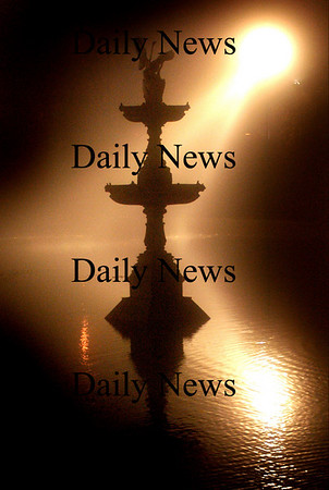 Newburyport: <br /> Spot lights at the Bartlett Mall give an eerie glow behind the fountain in the fog Saturday night.<br /> Photo by Jim Vaiknoras/Newburyport Daily News. Sunday, November 6, 2005