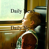 Newburyport: Brady Ford, of Newburyport, looks patiently out the window on the commuter rail as the train was stuck in Beverly, due to a malfunction with the drawbridge into Salem. Photo by Ben Laing/Newburyport Daily News Thursday June 19 2008.