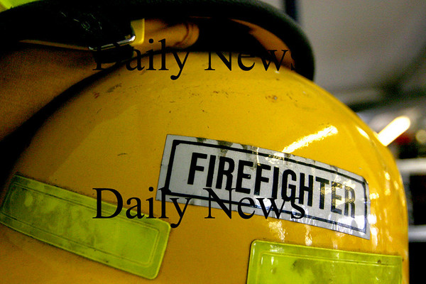 Georgetown:<br /> A helmet rests on a shelf at the Erie 4 Fire Hall in Georgetown. The Erie 4 company is a private fire fighting unit that serves Georgetown and must raise their own funds to pay for their operation.<br /> Photo by Ben Laing/Town Crossings Friday, March 30, 2007