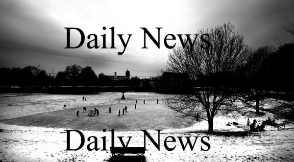 Newburyport:Skaters glide along the Frog Pond on the Bartlett Mall as clouds promising a snowy week move in over head.<br /> Photo by Jim Vaiknoras/Newburyport Daily News Sunday, December 09, 2007