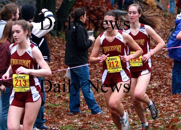 FranklinPark, Boston: Maura Welch (213), Kim Smith (212), and Samatha Baribeault (204) all of Newburyport HS are running at the 1 mile mark in the MIAA EMass Division 4 Girl's race at Franklin Park in Boston.   <br /> <br /> Photo by Andy Baumgartner/Eagle-Tribune Saturday, November 08, 2008