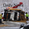 Salisbury: A DPW plow truck, involved in an earlier accident,  fell off a flatbed trailer in Salisbury, spilling sand all over March Street. Photo by Katie Curley/Newburyport Daily News Monday March 9, 2009.