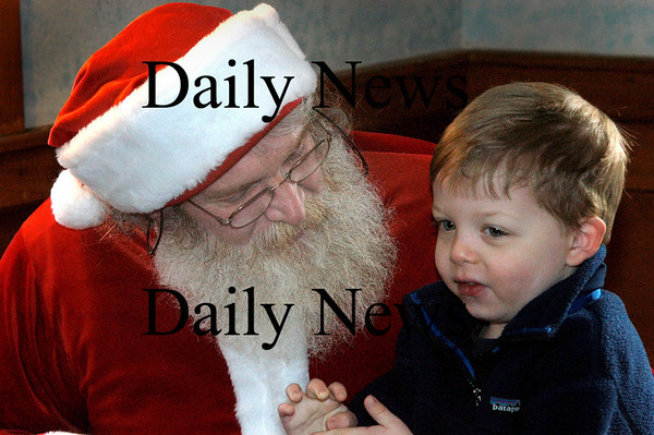 Newburyport: <br /> Ross Cooper, 4, of Boxfor talks with Santa Claus in his workshop on Inn Street.<br /> Photo by Jim Vaiknoras/Newburyport Daily News. Wednesday, December 22, 2004
