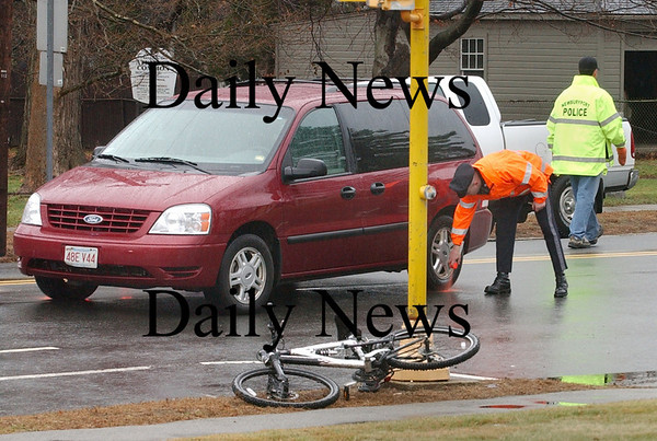 Newburyport: <br /> Police mark the position of a van involved in an accident with a man on a bike late yesterday morning on High Street near Atkinson Common. The rider was unconscious when taken from the scene and was medflighted to a Boston hospital.<br /> Photo by Bryan Eaton/Newburyport Daily News. Monday, December 11, 2006