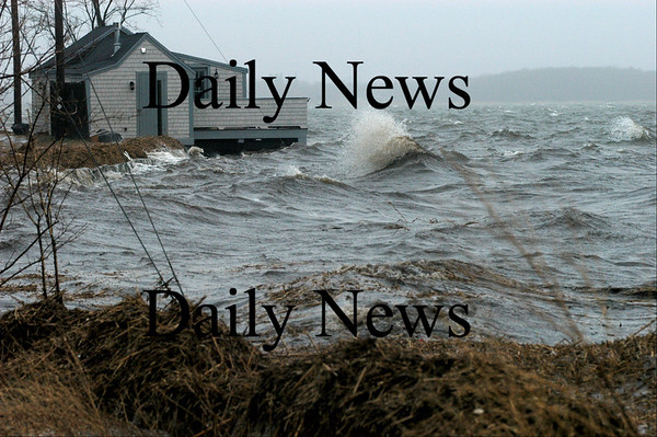 Newburyport: Waves on Joppa Flats hit the clam shack on Water Street at high tide Monday.<br /> Photo by Jim Vaiknoras/Newburyport Daily News. Monday, April 16, 2007