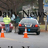 Newburyport: <br /> Police at the scene of an accident involving a bicylist on High Street in front of the Griffin House for Aged Men late Monday morning. The man who was medflighted to Brigham and Women's Hospital in Boston has died.<br /> Photo by Bryan Eaton/Newburyport Daily News. Tuesday, December 12, 2006