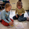 Rowley: Pine Grove School first graders Sage Woodward, left, and Emily Brimicombe play a game of dice that teaches them counting and math skills.  The girls are in Colleen Lang's class.  Michelle Marshal Pelletier Photo<br />  <br />  <br />                                <br /> , Rowley: Pine Grove School first graders Sage Woodward, left, and Emily Brimicombe play a game of dice that teaches them counting and math skills.  The girls are in Colleen Lang's class.  Michelle Marshal Pelletier Photo