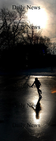 Newbury: <br /> Marcia Sutton, 11, casts a long shadow as she skates on the Upper green late Sunday afternoon.<br /> Photo by Jim Vaiknoras/Newburyport Daily News. Sunday, December 18, 2005