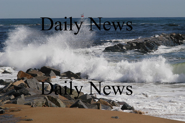 Newburyport:<br /> A wave crashes in the breach of the south jetty of the Merrimack River on Plum Island. The tower at the end of the north jetty on the Salisbury side can be seen in back, center of photo.<br /> Photo by Bryan Eaton/Newburyport Daily News Wednesday, March 19, 2008