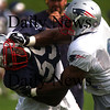 Foxboro:<br /> Linebacker Roosevelt Colvin, blue, and Tight End Ben Watson, white, meet head on during a blocking drill at the Patriots first day of training camp.<br /> Photo by Ben Laing/Eagle-Tribune Friday, July 27, 2007