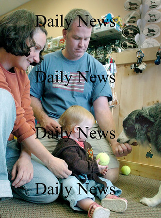 Newburyport: <br /> Dawn and Jeff Price get their dog Crystal acquainted with their daughter Teagan.<br /> Photo by Bryan Eaton/Newburyport Daily News. Friday, September 15, 2006