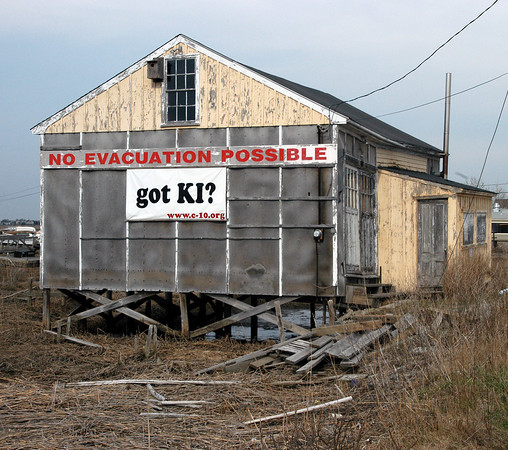 Newbury: <br /> The No Evacuation Possible sign on the Plum Island Turnpike. with getting acquainted.<br /> Photo by Jim Vaiknoras/Newburyport Daily News. Sunday, April 18, 2004