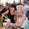 Salisbury:<br /> Katherine Novak, left, of Newburyport and Janet Loring of Newbury enjoy champagne while jotting down notes to Doug Morris' salad dressing recipes.<br /> Photo by Bryan Eaton/Newburyport Daily News Friday, September 12, 2008