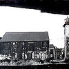 Newburyport: Seen through the rotting hulk of a vessel is the riverside facades of the Newburyport Art Association building. <br /> Photo by Urban Renewal/Newburyport Daily News. Wednesday, April 4, 2007