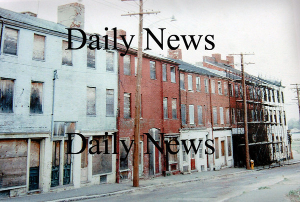 Newburyport: <br /> Inn Street before Urban Renewal when cars still traveled by the dilapitated buildings.<br /> Photo by Handout/Newburyport Daily News. Monday, April 30, 2007