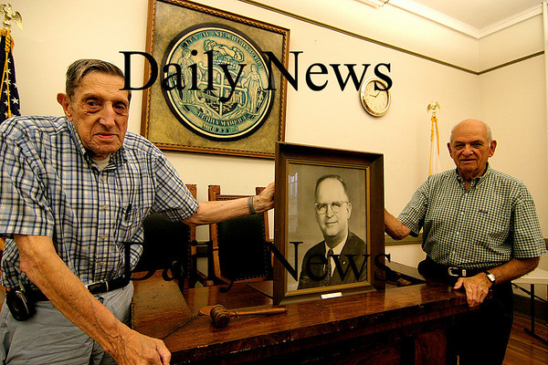 Newburyport:<br /> Former Mayors, George Lawler, left, and Byron Matthews, right, stand in the Newburyport City Council Chambers with a picture of another former Mayor of Newburyport, Al Zabriskie.<br /> Photo by Ben Laing/Newburyport Daily News Friday, July 20, 2007