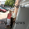 Newburyport: ....with his daughter... at the site of his home on Unicorn Street<br /> Photo by Jim Vaiknoras/Newburyport Daily News. Tuesday, June 26, 2007