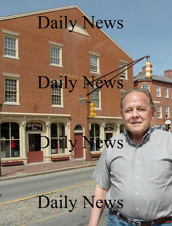 Newburyport: <br /> Chris Snow returns in front of the building that housed a bowling alley in Market Square.<br /> Photo by Bryan Eaton/Newburyport Daily News. Wednesday, April 25, 2007