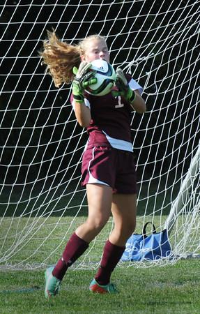 BRYAN EATON/Staff Photo. Newburyport goalie Jennifer Stuart makes the catch of a Masconomet shot on net.