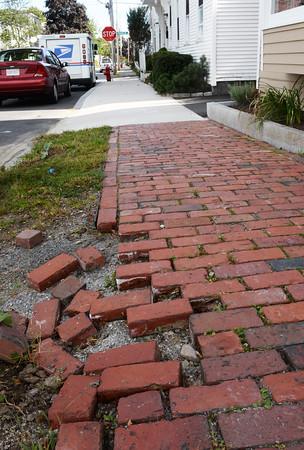 BRYAN EATON/Staff Photo. Sidewalk in need of repair in front of 22 Purchase Street in Newburyport.