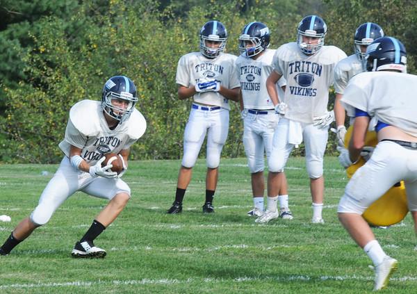 BRYAN EATON/Staff Photo. A Triton receiver makes a catch in practice.