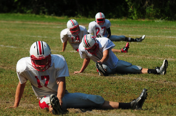 JIM VAIKNORAS/Staff photo <br /> Players stretch at Amesbury football practice.