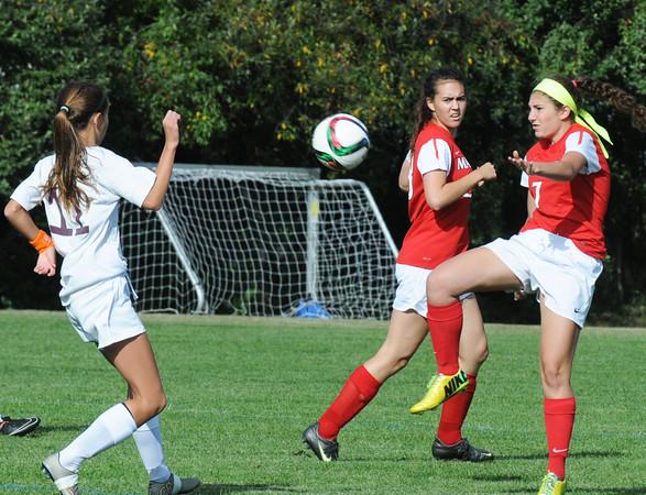 BRYAN EATON/Staff Photo. Masconomet's Gabby DeSimone knees the ball into Newburyport territory.