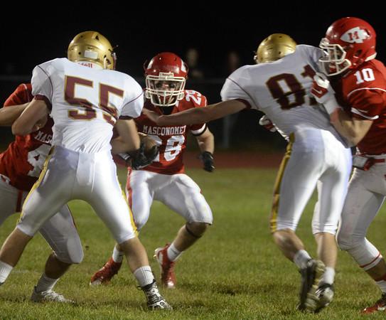 BRYAN EATON/Staff Photo. Masconomet's Adam Story runs into some Newburyport defense.