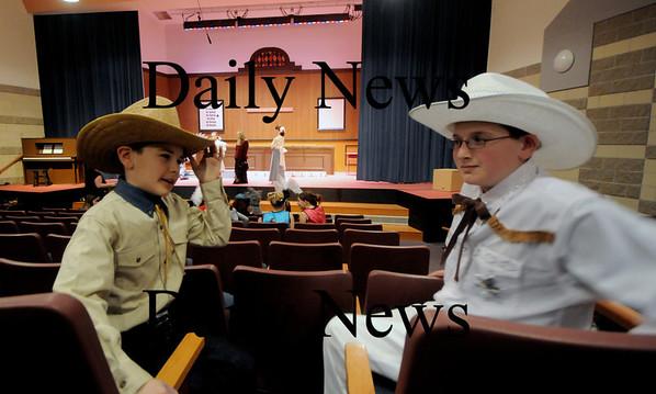 newbury: Ben Hall as Deputy Fields and Jake Burns as Marshall Goodie at the dress rehearsal for Sarsaparilla and Pearls at the Newbury Elementary School. Jim Vaiknoras/Staff photo