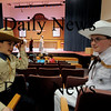 newbury: Ben Hall as Deputy Fields and Jake Burns as Marshall Goodie at the dress rehearsal for Sarsaparilla and Pearls at the Newbury Elementary School. Jim Vaiknoras/Staff photo
