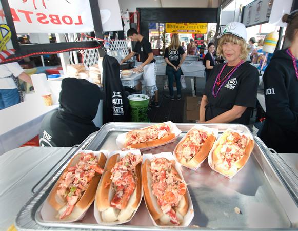 Hampton: The 401 Tavern serves up its lobster rolls at the Hampton Beach Seafood Festival. Jim Vaiknoras/Staff Photo