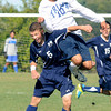 Byfield: Triton's Jacob Papanicolaou heads a ball with Hamilton-Wenham's Sam Greenwald during their game at Triton Friday afternoon. Jim Vaiknoras/staff photo