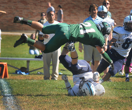 West Newbury: Pentucket's Luke Strangman dives over Triton's Justin Cashman as he tries to break up a pass during their game at Pentucket Saturday afternoon. Jim Vaiknoras/staff photo