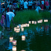 Newburyport: Lanterns are put in the frog pond at the Bartlet Mall in Newburyport Sunday night as part of the third annual  Overian Cancer Awareness Lantern Festival. Jim Vaiknoras/staff photo