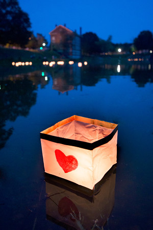 Newburyport:One of hundreds of  lanterns float on the frog pond at the Bartlet Mall in Newburyport Sunday night as part of the third annual  Overian Cancer Awareness Lantern Festival. Jim Vaiknoras/staff photo