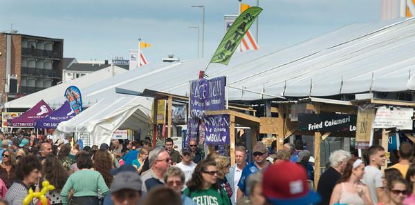 Hampton: Throngs fill the roadway at the Hampton Beach Seafood Festival last year. Jim Vaiknoras/Staff Photo