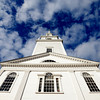 Newburyport: The Unitarian church on Pleasent Street in Newburyport stands against a sky of blue and puffy white clouds. Jim Vaiknoras/staff photo