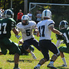 West Newbury: Triton's Justine Spillanelooks for running room during the Viking's game at Pentucket Saturday afternoon. Jim Vaiknoras/staff photo