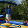 Jim Vaiknoras/staff photo. Michael Perry of Groveland celebrated defeating his son Cullen,6, in an inflatable jousting game at Groveland Days Saturday at the Groveland Recreation Fields. the victory was short lived as Cullen won the next 2 bouts.