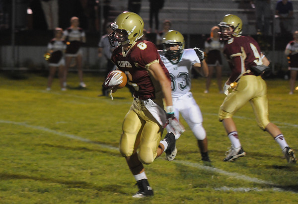 Newburyport: Newburyport's Drew Bourdeau runs back the opening kick off for a touch down during the Clippers home game against North Reading Friday night. Jim Viknoras/staff photo
